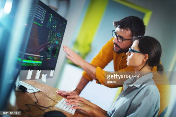 software developers doing some research. - coding stock pictures, royalty-free photos & images