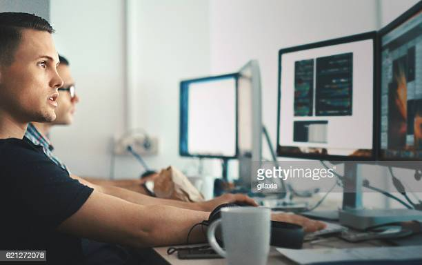 software developers. - information technology support stock photos and pictures
