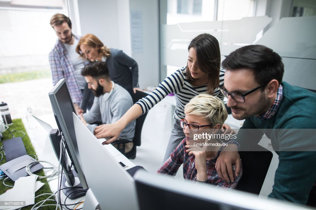 Software developers solving a problem : Stock Photo
