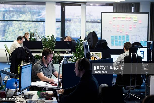 Software developers work at computer screens at the SAP SE office in Budapest Hungary on Tuesday Oct 20 2015 SAP shares rose 02 percent to 6628 euros...
