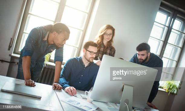 software developing startup company. - smart casual stock pictures, royalty-free photos & images