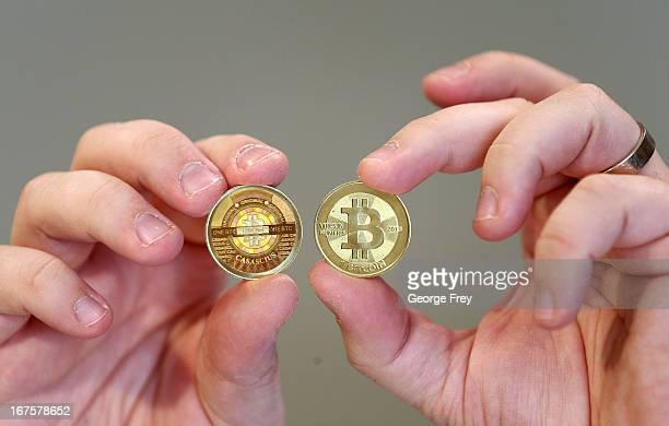 Software engineer Mike Caldwell shows the front and back hologram side of a physical Bitcoin he minted in his shop on April 26 2013 in Sandy Utah...