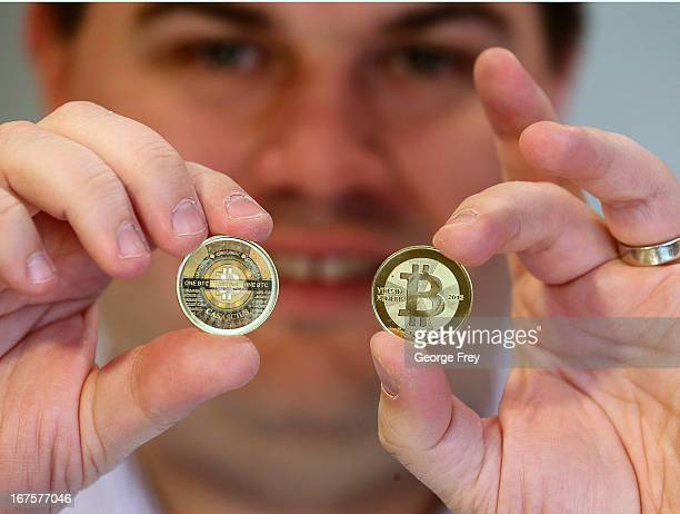 Software engineer Mike Caldwell shows the front and back of a physical Bitcoin he minted in his shop on April 26 2013 in Sandy Utah Bitcoin is an...