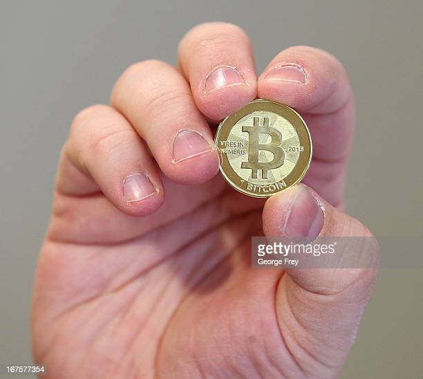 Software engineer Mike Caldwell shows the front of a physical Bitcoin he minted in his shop on April 26 2013 in Sandy Utah Bitcoin is an experimental...