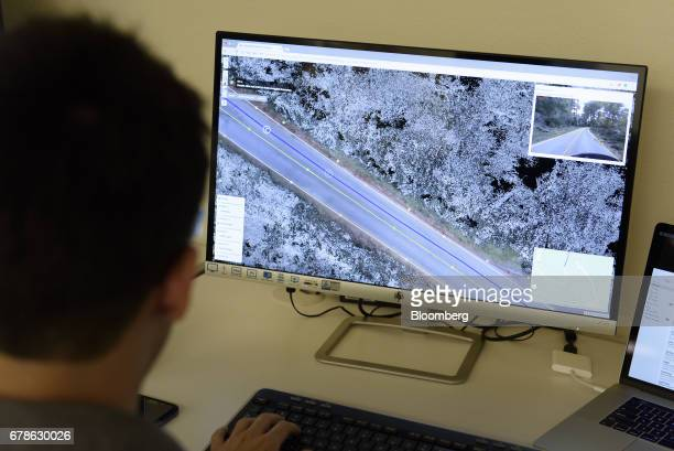 A software engineer views a map illustrated on a computer monitor at the DeepMap Inc office in Palo Alto California US on Wednesday April 5 2017...