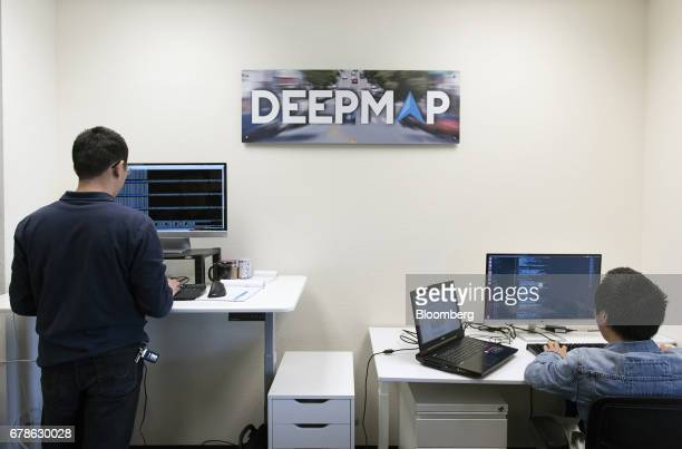 Software engineers work on code at the DeepMap Inc office in Palo Alto California US on Wednesday April 5 2017 DeepMap Inc which was founded by...