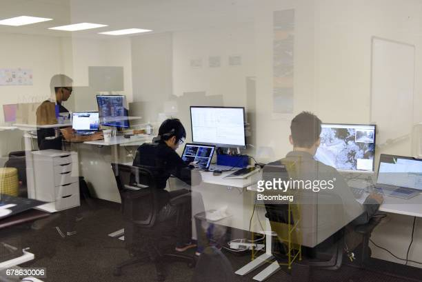 Software engineers work on mapping and writing code at the DeepMap Inc office in Palo Alto California US on Wednesday April 5 2017 DeepMap Inc which...