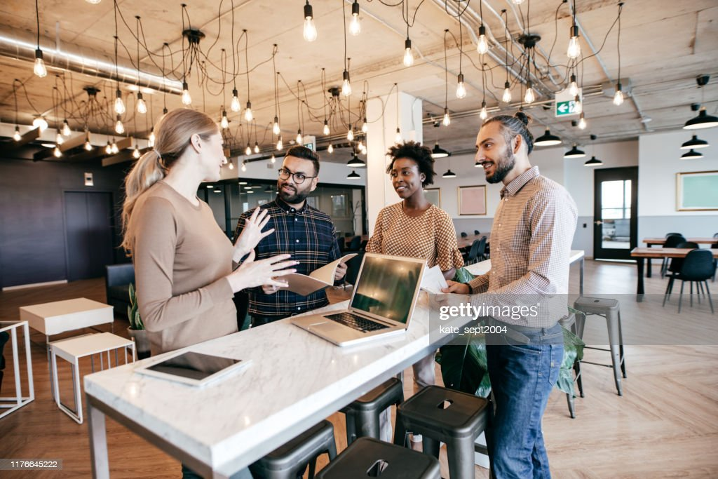 Software engineers working on project and programming in company : Stock Photo