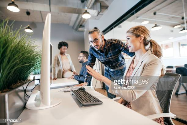 software engineers working on project and programming in company - employee appreciation stock pictures, royalty-free photos & images