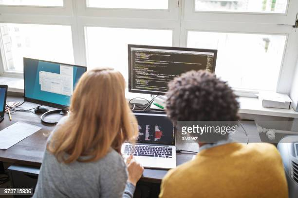 software engineers working together on new project - coding stock pictures, royalty-free photos & images