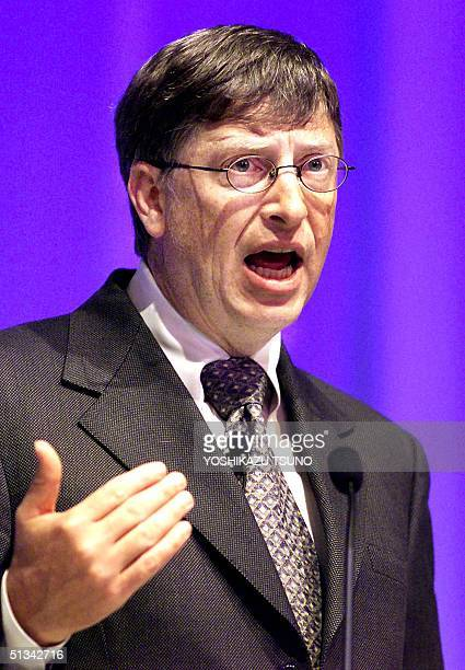 "Software giant Microsoft Chairman Bill Gates gives a speech at a conference on ""e-government"" at a Tokyo hotel, 16 October 2001. Gates is here for..."
