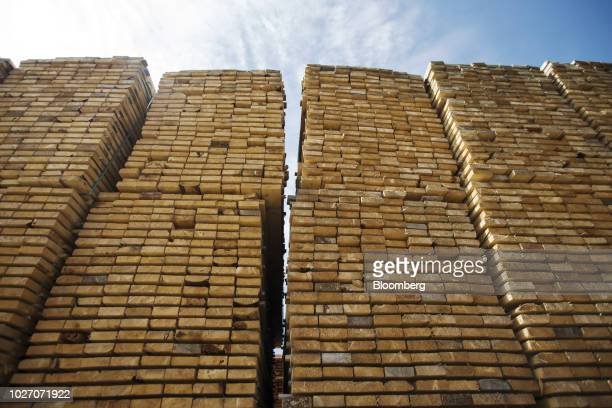 Softwood lumber sits in stacks at the Groupe Crete Inc. Sawmill in Chertsey, Quebec, Canada, on Tuesday, Sept. 4, 2018. Lumber futures for November...