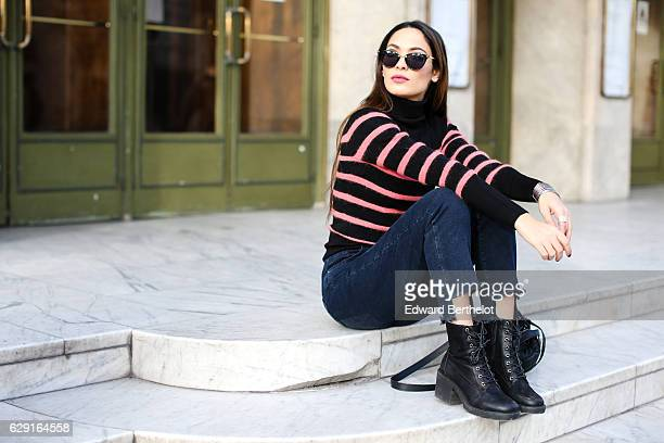 Sofya Benzakour, fashion and life style blogger @lacouleurdumoment, is wearing River Island shoes, Ikks blue denim jeans, an Ikks black bag, a black...