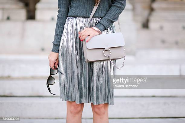 Sofya Benzakour is wearing a Morgan silver skirt an Asos gray pull over New Look boots and a Nakd Fashion bag on October 29 2016 in Paris France