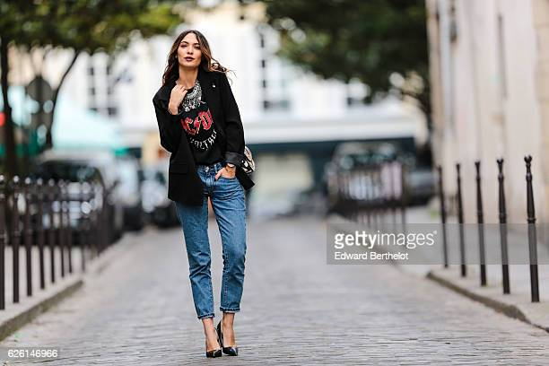 Sofya Benzakour is wearing a Zara tshirt with the ACDC rock band logo Reiko blue denim jeans Zara black heels shoes a Tobi black jacket a Forever 21...