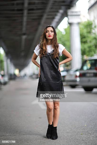 Sofya Benzakour is wearing an Asos black dress an Asos white tshirt and black shoes during a street style session on May 23 2016 in Paris