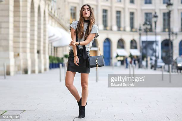 Sofya Benzakour is wearing Asos black shoes an Asos black skirt an Asos white top and a Saint Laurent YSL black bag during a street style session on...