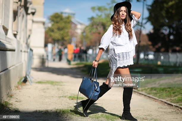 Sofya Benzakour wearing a Dahlia shirt a Valentino bag and Zara hat boots and short after the Mugler show during the Paris Fashion Week SS16 on...
