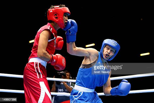 Sofya Ochigava of Russia competes Alexis Pritchard of New Zealand during the Women's Light Boxing Quarterfinals on Day 10 of the London 2012 Olympic...