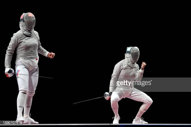 Sofya Velikaya of Team ROC and Sofia Pozdniakova of Team ROC appeal for a point in the Women's Sabre Individual Fencing Gold Medal Bout on day three...