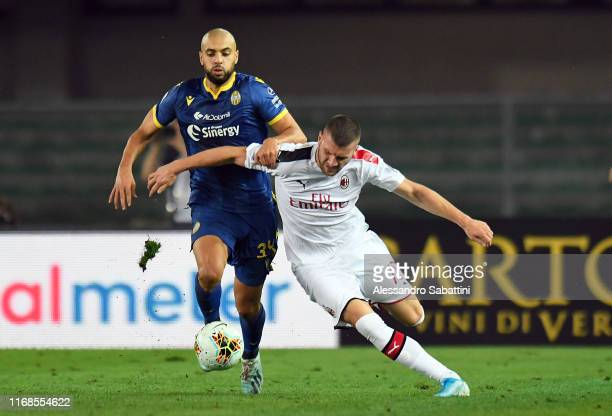Sofyan Ambrabat of Hellas Verona competes for the ball with Ante Rebic of AC Milan during the Serie A match between Hellas Verona and AC Milan at...