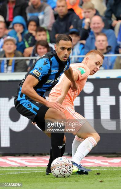 Sofyan Amrabat and Adrien Trebel fight for the ball during the Jupiler Pro League match day 5 between Club Brugge and Rsc Anderlecht on August 26...