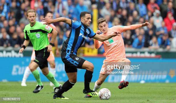 Sofyan Amrabat and Pieter Gerkens fight for the ball during the Jupiler Pro League match day 5 between Club Brugge and Rsc Anderlecht on August 26...