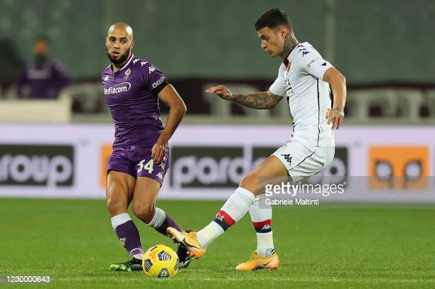 Sofyan Amrabat of ACF Fiorentina battles for the ball with Gianluca Scamacca of Genoa CFC during the Serie A match between ACF Fiorentina and Genoa...
