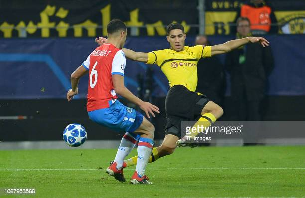 Sofyan Amrabat of Bruegge and Achraf Hakimi of Dortmund battle for the ball during the Group A match of the UEFA Champions League between Borussia...