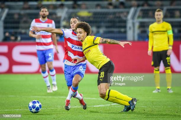 Sofyan Amrabat of Bruegge Axel Witsel of Dortmund battle for the ball during the Group A match of the UEFA Champions League between Borussia Dortmund...
