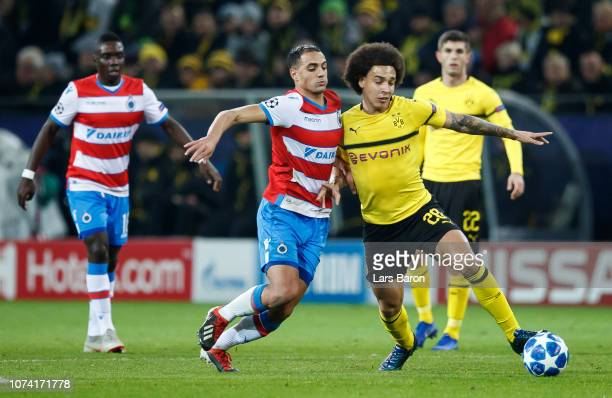 Sofyan Amrabat of Brugge challenges Axel Witsel of Dortmund during the Group A match of the UEFA Champions League between Borussia Dortmund and Club...