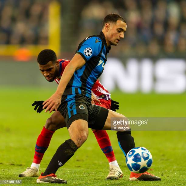 Sofyan Amrabat of Club Bruegge and Thomas Lemar of Club Atletico battle for the ball during the UEFA Champions League Group A match between Club...