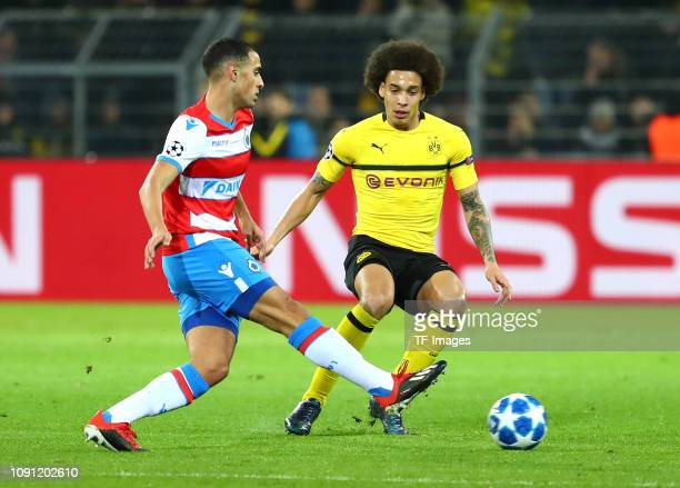 Sofyan Amrabat of Club Brugge and Axel Witsel of Borussia Dortmund battle for the ball during the Group A match of the UEFA Champions League between...