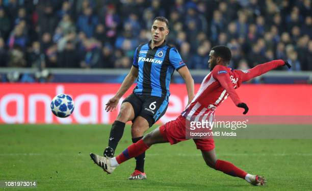 Sofyan Amrabat of Club Brugge and Thomas Lemar of Atletico fight for the ball during the UEFA Champions League Group A match between Club Brugge and...