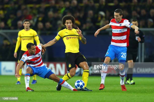 Sofyan Amrabat of Club Brugge battles for possession with Axel Witsel of Borussia Dortmund and Hans Vanaken of Club Brugge during the UEFA Champions...