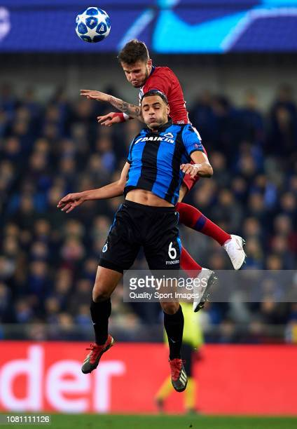 Sofyan Amrabat of Club Brugge competes for the ball with Saul Niguez of Atletico de Madrid during the UEFA Champions League Group A match between...