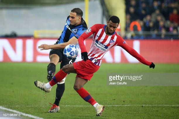 Sofyan Amrabat of Club Brugge Thomas Lemar of Atletico Madrid during the UEFA Champions League Group A match between Club Brugge KV and Club Atletico...
