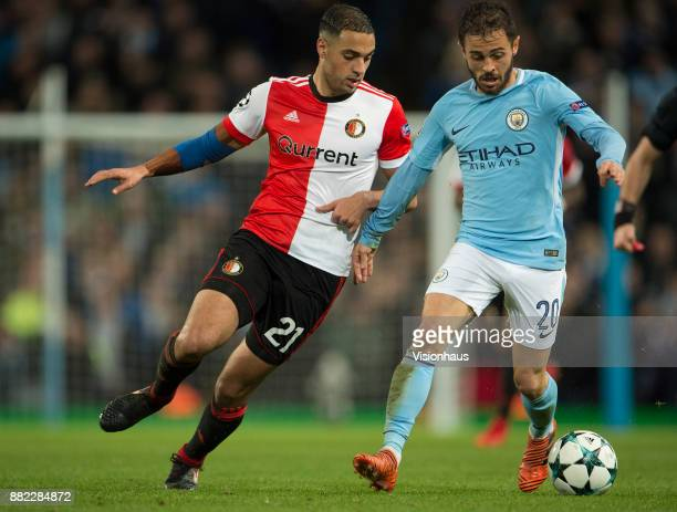 Sofyan Amrabat of Feyenoord and Bernardo Silva of Manchester City during the UEFA Champions League group F match between Manchester City and...