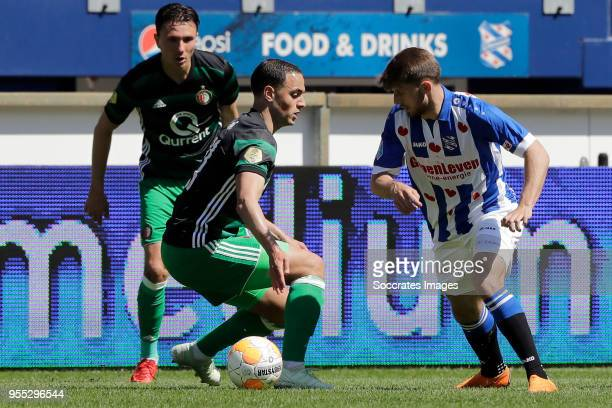 Sofyan Amrabat of Feyenoord Arber Zeneli of SC Heerenveen during the Dutch Eredivisie match between SC Heerenveen v Feyenoord at the Abe Lenstra...