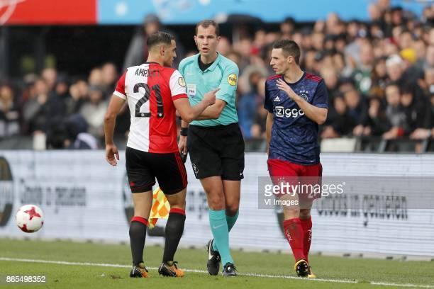 Sofyan Amrabat of Feyenoord assistant referee Hessel Steegstra Nick Viergever of Ajax during the Dutch Eredivisie match between Feyenoord Rotterdam...