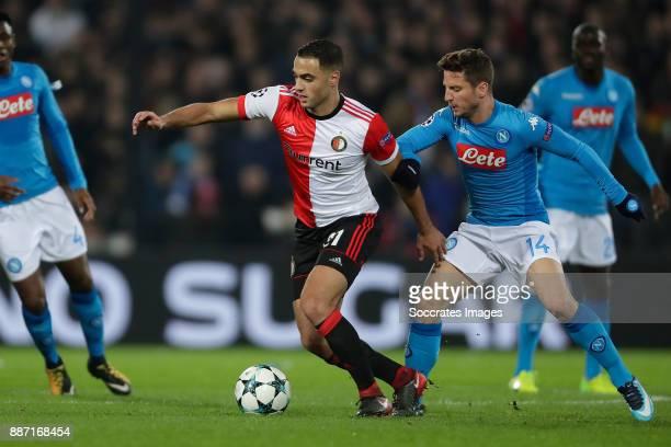 Sofyan Amrabat of Feyenoord Dries Mertens of Napoli during the UEFA Champions League match between Feyenoord v Napoli at the Feyenoord Stadium on...