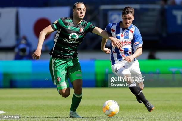 Sofyan Amrabat of Feyenoord Jizz Hornkamp of SC Heerenveen during the Dutch Eredivisie match between SC Heerenveen v Feyenoord at the Abe Lenstra...