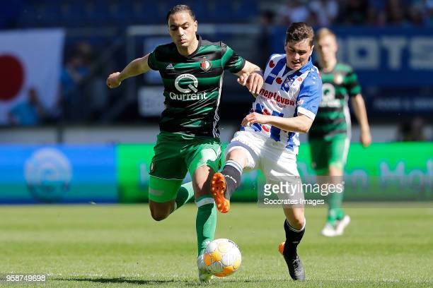 Sofyan Amrabat of Feyenoord Jizz Hornkamp of SC Heerenveen during the Dutch Eredivisie match between SC Heerenveen v Feyenoord at the Abe Lenstra...