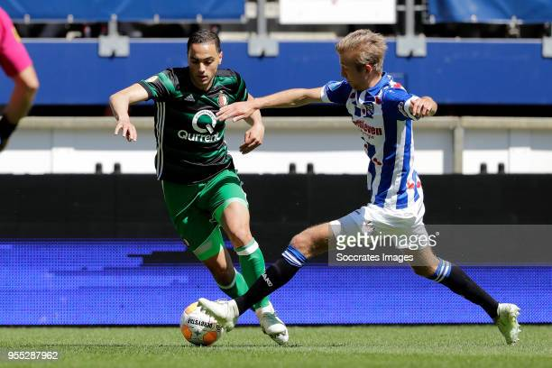 Sofyan Amrabat of Feyenoord Michel Vlap of SC Heerenveen during the Dutch Eredivisie match between SC Heerenveen v Feyenoord at the Abe Lenstra...