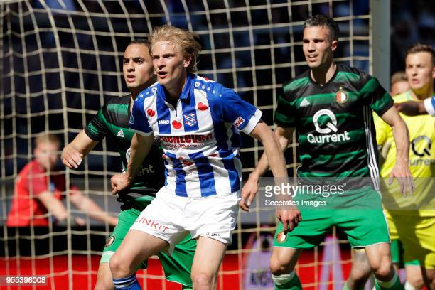 Sofyan Amrabat of Feyenoord Morten Thorsby of SC Heerenveen Robin van Persie of Feyenoord during the Dutch Eredivisie match between SC Heerenveen v...