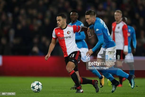Sofyan Amrabat of Feyenoord Piotr Zielinksi of Napoli during the UEFA Champions League match between Feyenoord v Napoli at the Feyenoord Stadium on...
