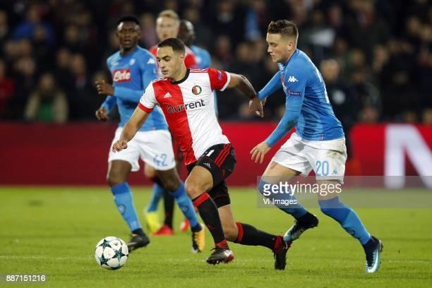 Sofyan Amrabat of Feyenoord Piotr Zielinski of SSC Napoli during the UEFA Champions League group F match between Feyenoord Rotterdam and SSC Napoli...