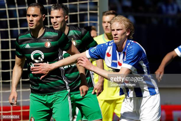 Sofyan Amrabat of Feyenoord Robin van Persie of Feyenoord Morten Thorsby of SC Heerenveen during the Dutch Eredivisie match between SC Heerenveen v...