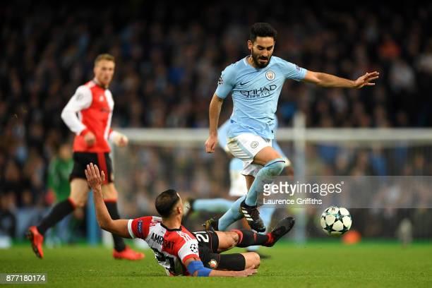 Sofyan Amrabat of Feyenoord tackles Ilkay Gundogan of Manchester City during the UEFA Champions League group F match between Manchester City and...