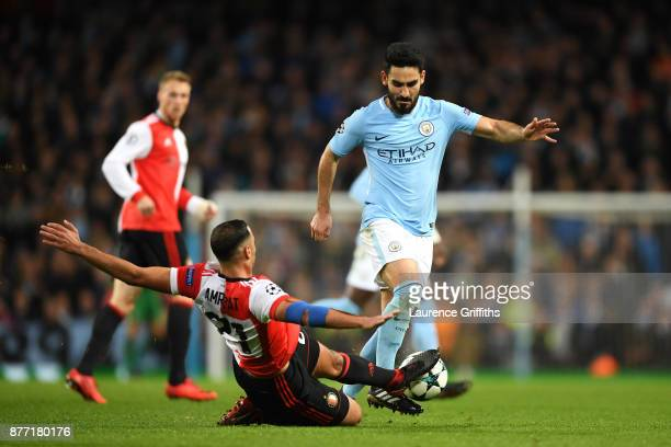 Sofyan Amrabat of Feyenoord tackles Ilkay Gundogan of Manchester City during the UEFA Champions League group F match between Manchester City and...